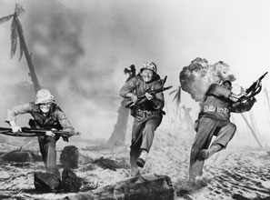 In Sands of Iwo Jima (1949), John Wayne's Sergeant Stryker (center) must steep himself in violence, and make physical and spiritual sacrifices, to defend civilization. (Republic Pictures Corporation/Photofest)
