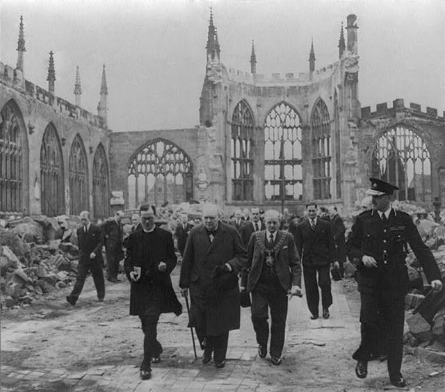 Winston Churchill walks through the ruined nave of Coventry Cathedral, 1941 (Library of Congress)