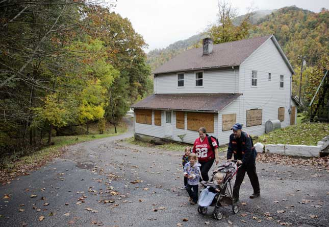 Based on an unproven belief that fossil fuels are a dire threat to humanity, arbitrary regulation is killing the Kentucky town of this out-of-work coal miner and his family. (DAVID GOLDMAN/AP PHOTO)