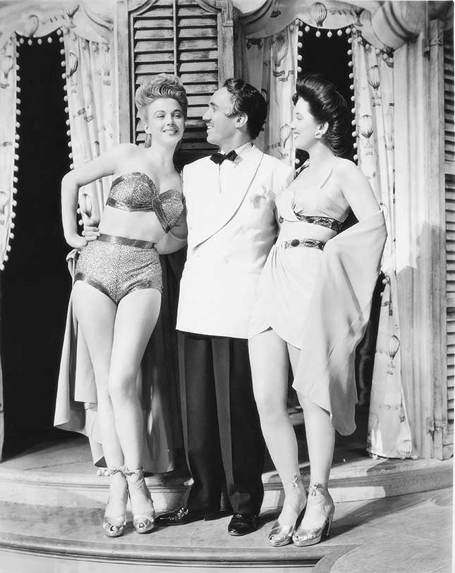 Richard Kollmar with two of the famous models featured in the production