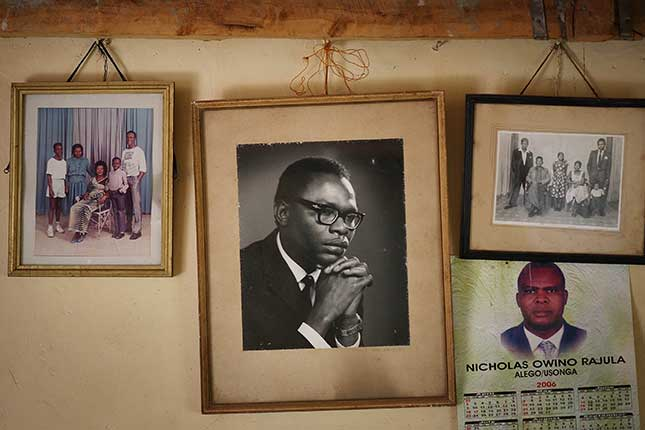 The president scarcely knew his Kenyan father, Barack Obama, Sr., whose portrait hangs (center) in the family house in Kogelo, western Kenya. (PETER MACDIARMID/GETTY IMAGES)