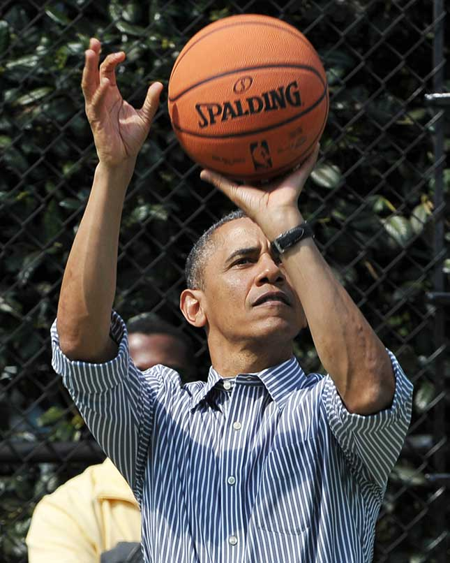 "The basketball his father gave him as a present was his first clue in the quest that spanned Obama's prep-school and college years: ""to raise myself to be a black man in America."" (MANDEL NGAN/AFP/GETTY IMAGES)"