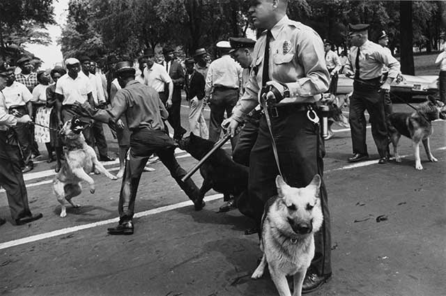 King's creed of nonviolence guided most protesters, including these in Birmingham, Alabama, in May 1963. And his message changed America's heart and government's policy, . . . (CHARLES MOORE/GETTY IMAGES)