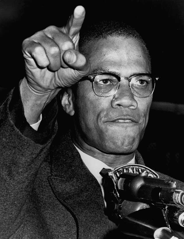 ". . . but that same month, more radical leaders, especially the fiery Malcolm X, began preaching the harsher doctrine of resistance to racist oppression ""by any means necessary,"" including violence. (BETTMANN/GETTY IMAGES)"
