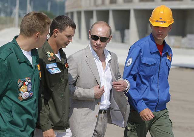 Vladimir Putin visiting the construction site of Sochi's Ice Palace in 2010 (RIA-NOVOSTI/THE IMAGE WORKS)