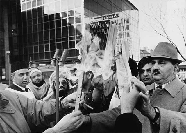 """Muslims burn copies of Salman Rushdie's """"Satanic Verses"""" in Bradford, U.K., in 1988. (DEREK HUDSON/GETTY IMAGES)"""
