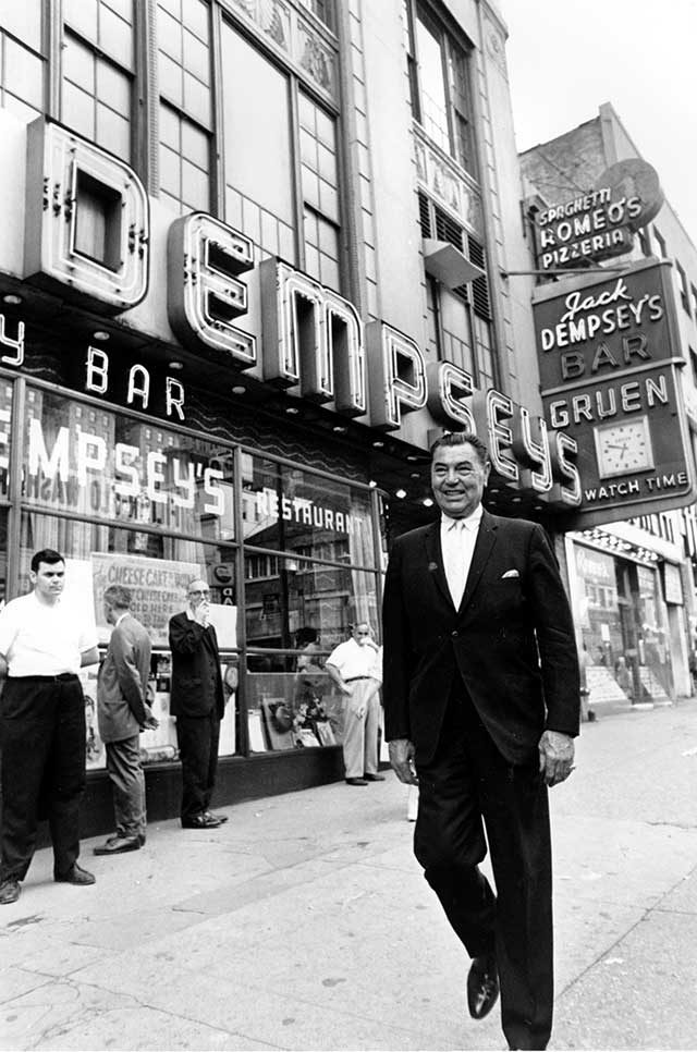 Jack Dempsey in front of his iconic Broadway restaurant, 1963 (AP PHOTO)