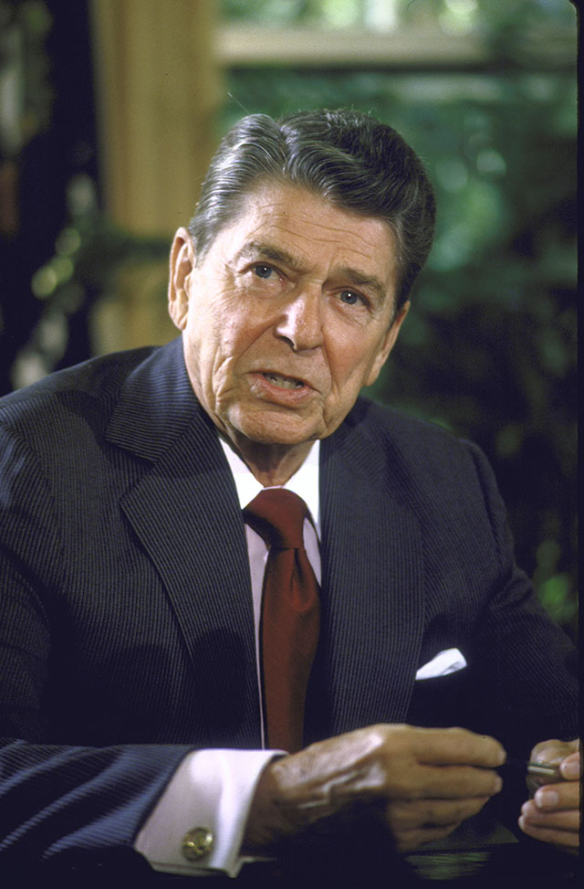 Coming to the Oval Office after a long period of high unemployment and crippling inflation, Ronald Reagan launched a tax campaign that took rates to a Coolidge-esque 28 percent—fueling a new expansion. (DIANA WALKER/TIME LIFE PICTURES/GETTY IMAGES)