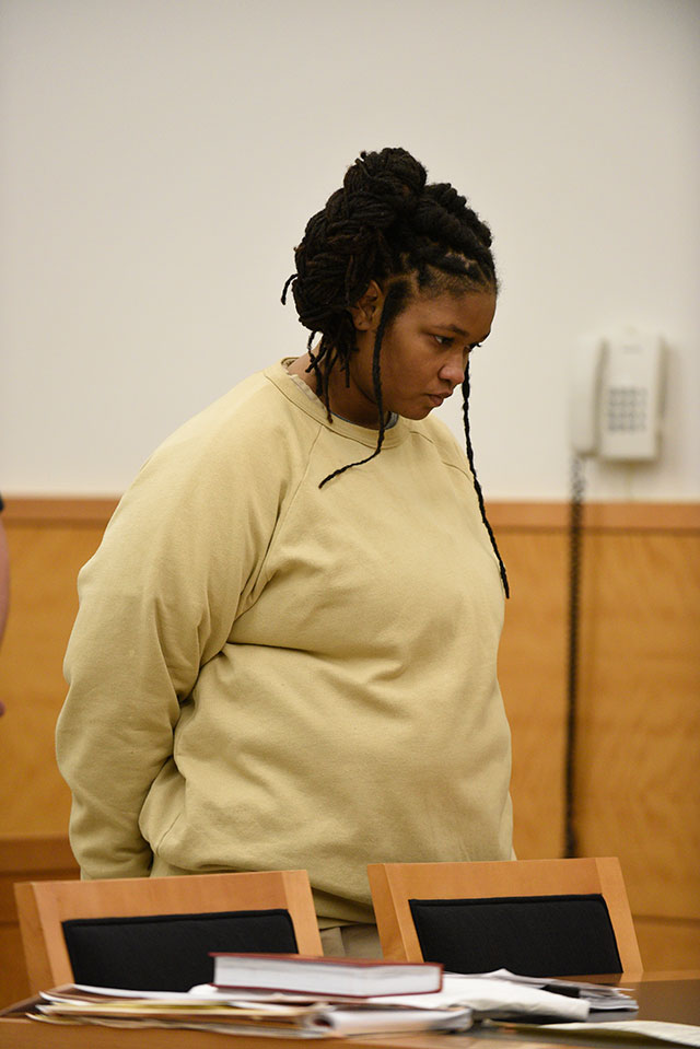 Zarah Coombs at a court appearance after being charged with beating to death her four-year-old son, Zamair, with a broomstick (BARRY WILLIAMS)