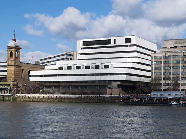 Like many Brutalist projects, Mondial House—a mutant eight-story ziggurat clad in bright white plastic on the Thames's north bank—had a short shelf life. It was demolished in 2006. (ARCHAEO IMAGES/ALAMY STOCK PHOTO)
