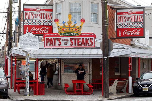 East Passyunk's Pat's King of Steaks, credited with creating the cheesesteak in 1933, is a Philadelphia culinary landmark. (ROBERT K. CHIN - STOREFRONTS/ALAMY STOCK PHOTO)
