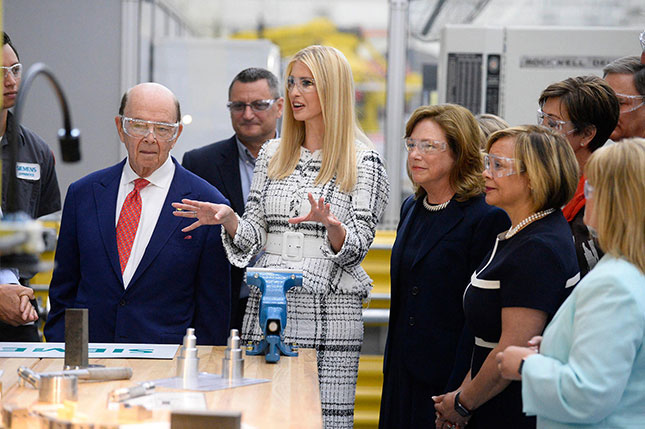 U.S. Secretary of Commerce Wilbur Ross and senior advisor to the president Ivanka Trump join company CEO Barbara Humpton (to right of Trump) at a Siemens USA facility. (DAVID T. FOSTER III/CHARLOTTE OBSERVER/TNS/ALAMY STOCK PHOTO)