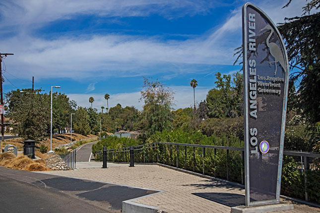 Los Angeles's River Revitalization plan has sparked numerous investments in the area, though it has also generated opposition from community groups fearing gentrification. (CITIZEN OF THE PLANET/UIG VIA GETTY IMAGES)