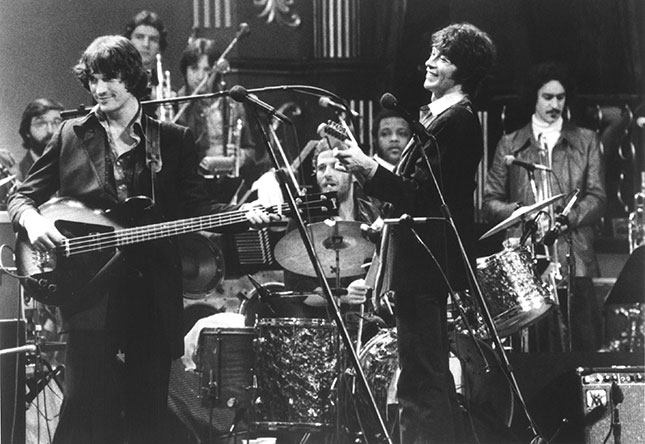 From left to right: Rick Danko, Levon Helm (behind drums), and Robbie Robertson, performing in their final concert, filmed by Martin Scorsese and released as The Last Waltz(MICHAEL OCHS ARCHIVES/GETTY IMAGES)