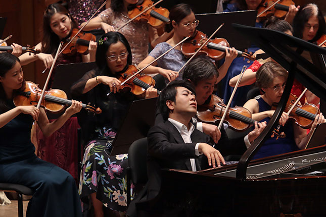 Asian musicians are disproportionately represented in modern orchestras. (HIROYUKI ITO/GETTY IMAGES)