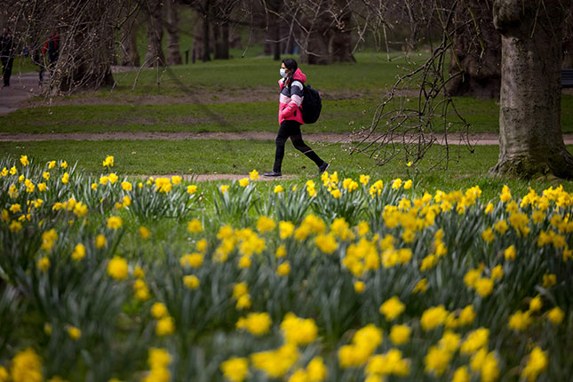 According to one survey, more than half of British citizens want to remain masked forever. (TOLGA AKMEN/AFP/GETTY IMAGES)