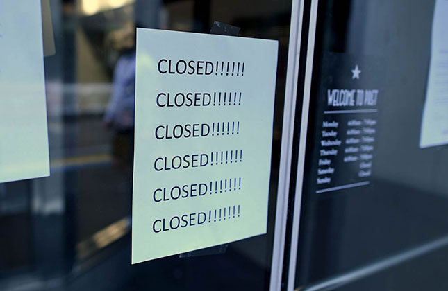 Save for a portion of grocery, pharmacy, and food-preparation and delivery workers in businesses permitted to continue operating, perhaps half a million jobs in leisure, hospitality, and retail are now gone. (Johannes Eisele/AFP/Getty Images)