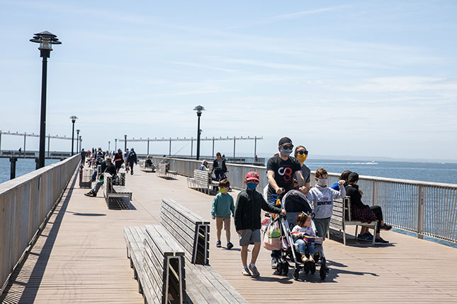 With further investment in quality of life, many areas of the city, including Coney Island, shown here, could become centers of remote work. (JEENAH MOON/BLOOMBERG/GETTY IMAGES)