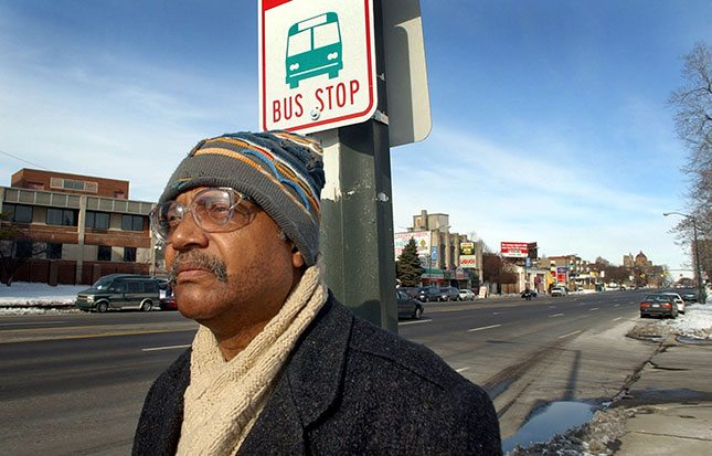 Trying to take a bus from downtown Detroit to the outskirts or suburbs involves long waits, often in isolated areas. (CARLOS OSORIO/AP PHOTO)