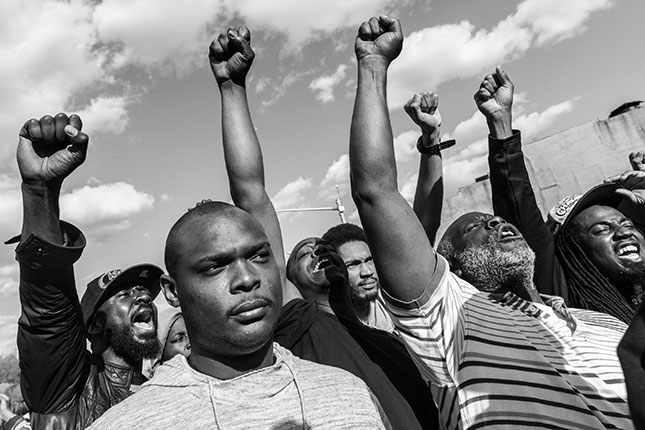 The death of Freddie Gray ignited Baltimore's spring 2015 riots, which pitted police against inner-city protesters. (Photo: Branden Eastwood/Reux)
