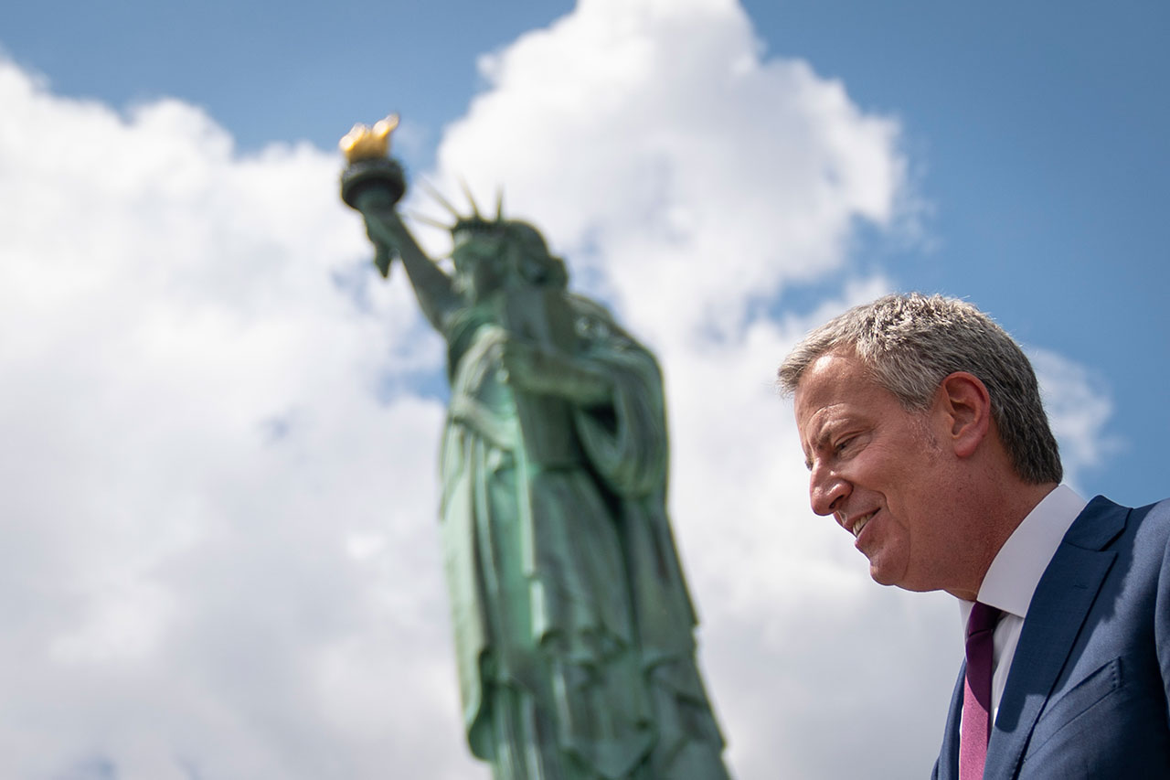 Free of Charge: For Bill de Blasio and other progressives, newcomers to the U.S. have no obligations.
