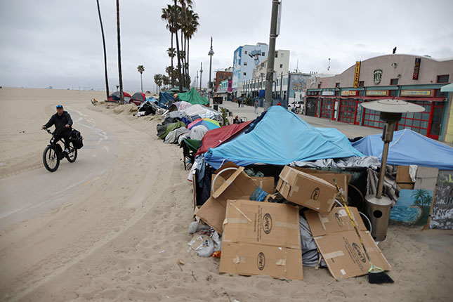 Permissive policies have fostered the formation of homeless encampments in Los Angeles and other cities. (REUTERS/ALAMY STOCK PHOTO)