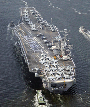 No pirates in these waters: the USS George Washington heads for Yokosuka, Japan.