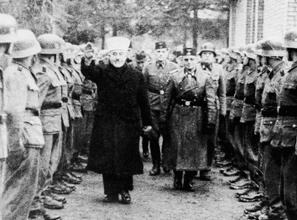 Ideological politics: the Grand Mufti of Jerusalem salutes Bosnian Muslim recruits to the Waffen-SS in 1943.