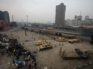 Demonstrators confront pro-Mubarak forces in Cairo's Tahrir Square.