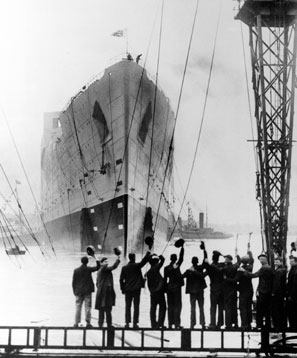 Well-wishers tip their hats to the Queen Mary as she is launched in 1934.