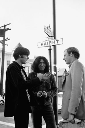 Wolfe (right) with the Grateful Dead's Jerry Garcia (center) and the band's manager, Rock Scully, in 1966 San Francisco