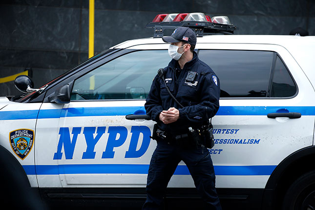 In today's adverse environment, police departments are facing recruitment shortages and an exodus of officers taking early retirement. (JOHN LAMPARSKI/GETTY IMAGES)