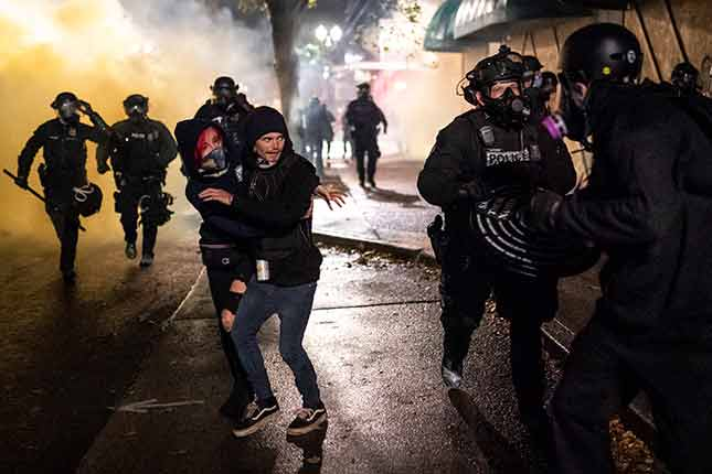 Portland has become a factory of political radicalism, the culminating expression of which is violence—as seen in the ongoing riots and street battles during the summer of 2020. (Nathan Howard/Getty Images)