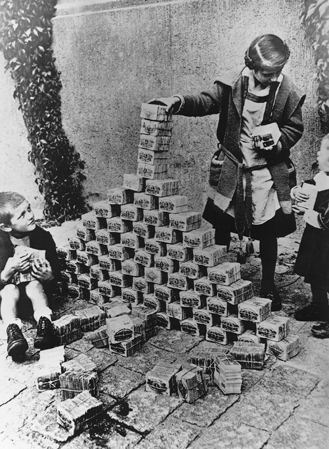 In Weimar-era Germany, the government recklessly printed money until it became almost valueless. (HULTON-DEUTSCH COLLECTION/CORBIS/GETTY IMAGES)
