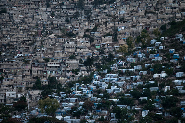 A tent camp in sewer-less Port-au-Prince, Haiti, where cholera rages (DAMON WINTER/THE NEW YORK TIMES/REDUX)
