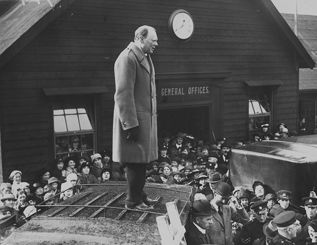 Secretary of State for War and Air Winston Churchill (1874 - 1965) standing on the roof of a van to address workers on a visit to the north of England. (Photo by Topical Press Agency/Getty Images)