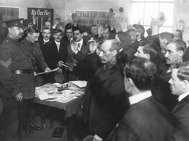 Army recruits taking the oath at offices in White City.  (Photo by Topical Press Agency/Getty Images)